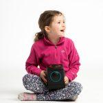 photographs of children intereacting with Skoog instrument