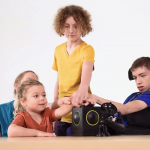 Group of children playing Skoog