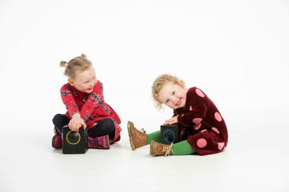 photographs of children intereacting with Skoog instrument